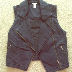 Forever 21 jean vest Gently worn. Great condition. Go perfectly with many styles, chic or cute. No flaws. I am selling it because it doesn't fit me anymore. Forever 21 Jackets & Coats Vests