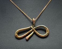 """Necklace with pendant in the shape of infinity """"melted"""". Electroformed copper, gold plating iridescent."""