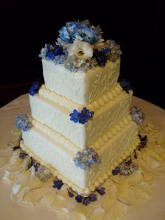 Three tier square wedding cake with blues and white decoration. www.Abbiesbakery.com www.facebook.com/abbiesbakery