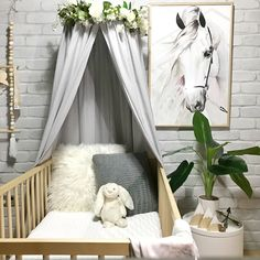 The Avery crib / cot canopy in grey creates the most welcoming, peaceful and serene space in your baby's nursery. A statement piece of nursery decor, enclosing your little baby in their cot, crib or bed away from the busy world for a sweet slumber or decor in an older kids bedroom as a quiet reading nook. I love that the canopy can grow with your child adapting to an array of uses. White peony floral wreath is also available online.