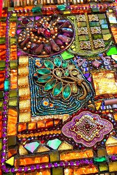 FROM A LAUREL SKYE CLASS. LOOKS LIKE PIECES ARE SET DIRECTLY INTO A THICK LAYER OF COLORED THINSET & NOT GROUTED. https://flic.kr/p/aqZZNu | Detail of Tapestry Mosaic | Most of these materials I…