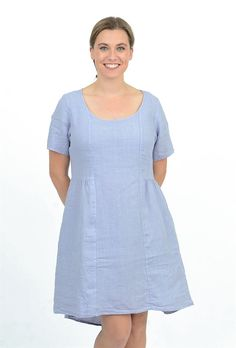 This easy-fitting silhouette is a customer favorite at Evie Lou. It has short sleeves a scoop neckline and gentle gathers at the empire waistline. Pockets at the hip add to its ease as does a row of small pleats at the low back. This version is done in a crisp linen.