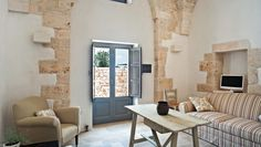 Masseria Fumarola: The converted trulli serve as guestrooms and feature lofty stone arches and limestone floors.