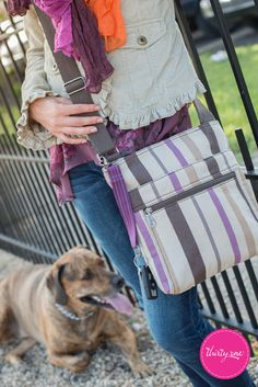 The Organizing Shoulder Bag in Purple Twill Stripe looks fantastic during a sunny walk in the park. www.mythirtyone.com/courtney