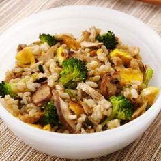 In this healthy vegetarian fried rice recipe, seitan, broccoli and mushrooms are tossed with creamy coconut milk and reduced-sodium soy sauce for a delicious one-bowl dinner.