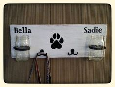 Perfect for the pet lover with two dogs. This dog leash holder and treat holder is painted in white on reclaimed wood and lightly distressed. It