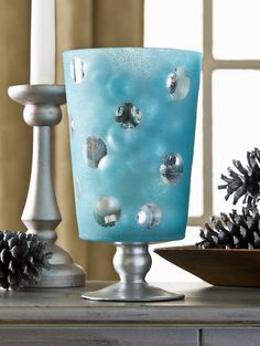 Create this winter centerpiece using glass paint and $1 stickers - it's so easy! You can fill it with leftover Christmas decor or anything you like.