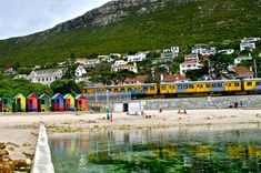 Muizenberg, South Africa. Love this view. Shows the iconic colorful huts and the train, which I know so well.