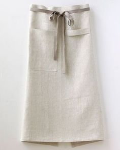 Our Bistro Apron was inspired by men who love to cook, and designed to fit both women and men comfortably. It is long and wide and universally just looks good. On the front, there's a loop of fabric t Sewing Hacks, Sewing Projects, Sewing Tips, Cafe Apron, Shop Apron, Restaurant Uniforms, Sewing Aprons, Linen Apron, Apron Designs