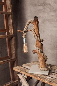 A personal favourite from my Etsy shop https://www.etsy.com/listing/479697468/driftwood-lamp-with-handmade-studs-loft
