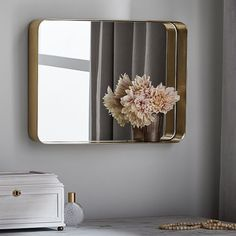 "Brass Beauty Mirror  DIMENSIONS Overall: 15"" wide x 3"" thick x 20"" high Mirror: 14.75"" wide x 19.75"" high Weight: 7.75 pounds"