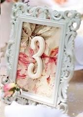 Table numbers with scrapbook paper scraps behind