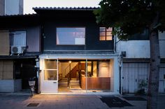 puddle architects before 9 is set inside one of the remaining three 'machiya' townhouses. the bar combines old and new to create a cozy interior.