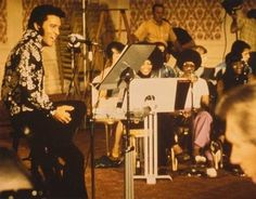 Elvis Presley rehearses for the That's The Way It Is documentary at the International Hotel in Las Vegas with The Sweet Inspirations and the TCB Band, August 4, 1970 (Courtesy of Metro-Goldwyn-Mayer)
