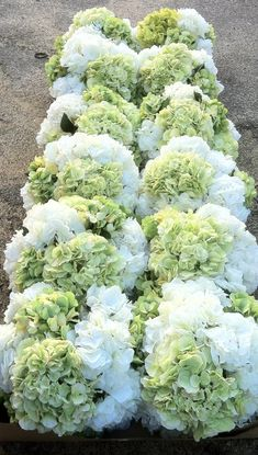 stunning white or cream and green hydrangea centerpiece add orange/red berries