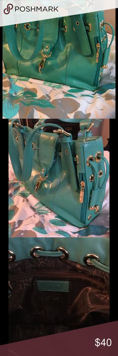 Handbag Beautiful leather handbag. The color is between light turquoise and sea foam green. The leather is soft and supple.   There is a small faint ink mark on back. the find Bags Shoulder Bags