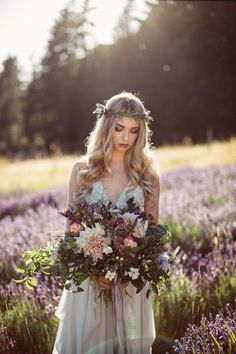 Perfect for an outdoor or bohemian wedding, a hand-tied bouquet and a bride with her flower crown.