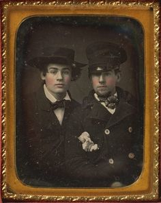 Daguerreotype portrait of two well-dressed young men wearing hats and blushed cheeks, ca. 1850