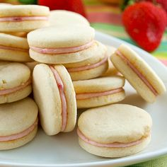 Strawberry Filled Lemon Sandwich Cookies - made these this weekend. They are AMAZING! The strawberry filling is so yummy Yummy Treats, Delicious Desserts, Sweet Treats, Yummy Food, Strawberry Filling, Strawberry Recipes, Strawberry Cookies, Cookie Recipes, Dessert Recipes