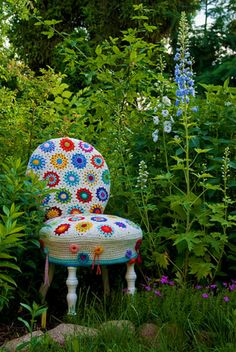 Kitschy Crochet Chair Cover ... perfect setting... I seriously want to yarn bomb my house