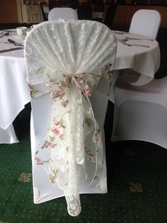 Beautiful vintage lace chair hood with floral organza sash. Available to hire from Make It Special Events, Atherstone, Warwickshire