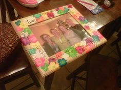 picture frame present for mom.   99 cent frame from michaels and fabric flowers mod-podged on