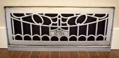 """25 inch VVI grille, Antique Pewter, with 6 inch base and dark 2.5"""" Hardwood flooring."""