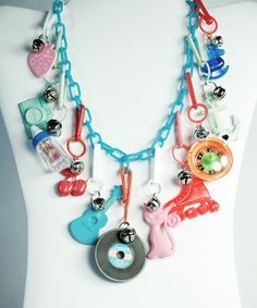 Remember when...we would wear these plastic charm necklaces and trade the charms with our friends!