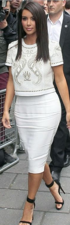 Who made Kim Kardashian's white skirt, gold studded short sleeve top, and black sandals that she wore in London? Shirt – Versace  Skirt – Lanvin  Shoes – Celine