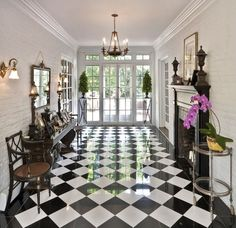 I grew up in a house on Lenox Place with a front hall like this--black and white checkerboard floor, the walls lined with antiques. Traditional Entry by Kim E Courtney Interiors & Design Inc Floor Design, Tile Design, House Design, Checkerboard Floor, Checkered Floors, Black And White Marble, Black And White Flooring, Kitchen Flooring, Tile Flooring