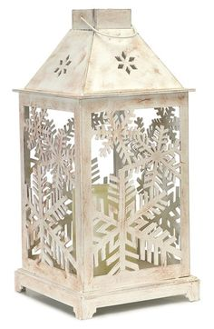 MELROSE GIFTS 'Snowflake' Flameless Candle Lantern at Nordstrom.com. Snowflake cutouts and a distressed finish add festive, rustic charm to an old-fashioned lantern with a built-in flameless candle to provide a warm, homey glow.