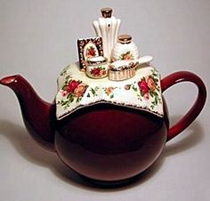 Oh! I have this china set - never knew about this teapot, though! Royal Albert China - Collector Teapots