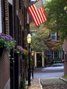 Window boxes and colonial flags mark tony Beacon Hill homes