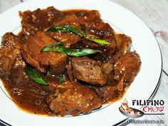 This is Humba. Humba is a dish similar to Pork Adobo. The only difference is the use of banana blossoms and black beans. Both dishes are good specially when you are eating it with plenty of steamed rice.  RECIPE: http://www.filipinochow.com/humba/