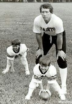 Archie Manning  sons (Eli and Peyton)