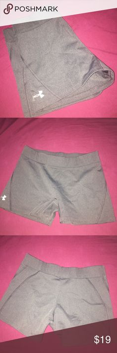 Under Armor Athletic Shorts Charcoal gray athletic shorts from Under Armor. The tag say medium but they would best fit a small. Only worn a few times. Under Armour Shorts