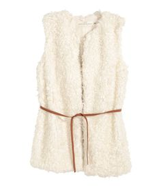 Cozy, natural white,faux fur vest with a narrow, imitation suede tie belt at waist. | Warm in H&M