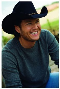 blake shelton.   hes the only man that im completely fine with wearing a cowboy hat. thats how much i love him.