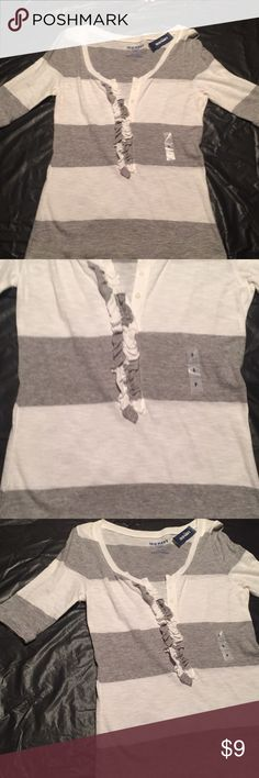 3/4 inch cotton shirt Gray and white striped 3/4 inch sleeve Old Navy cotton tee. Ruffled in front. Super comfortable. Brand new with tags. Old Navy Tops Tees - Long Sleeve