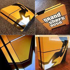 Playstation 4 in its GTAV gold PS4 skin.