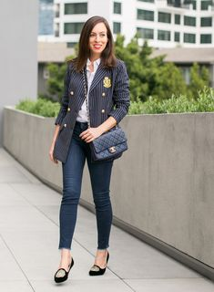 Sydne Style shows casual office outfit ideas in a white button down shirt and blazer