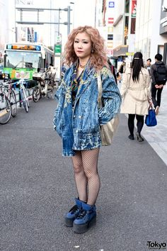 Miyuki is 20 years old and she works in the fashion industry. When we met her in Harajuku, she was wearing a resale acid wash denim jacket with fishnet stockings and #3rd #by #VANQUISH platform sneakers. #tokyofashion #street  snap #Harajuku