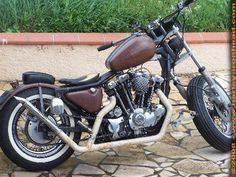 Photo of 1982 Harley Sportster bobber with Ironhead motor in a converted rigid frame by Francois.