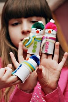 Snowman finger puppets-made with film canisters but toilet paper rolls would probably work too....