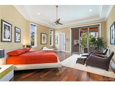 Contemporary master bedroom - orange - brown leather chairs.  Aqualane Shores in Naples, FL