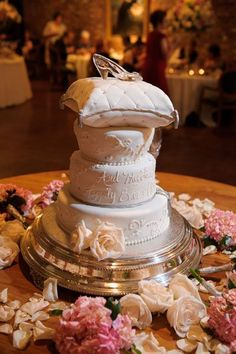 Express Yourself Through Cake - Design your cake to reflect your interests, home state, your occupation, your fandoms, or even favorite pop culture references. This bride's favorite fairytale became the motif for this amazing cake design.