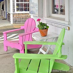 Colorful neon pink and lime green beach chairs (aka lawn chairs or Adirondack chairs) on the sidewalk outside a shop in Watch Hill, Rhode Island, United States USA with a potted plant (pink geranium) on a table. Adirondack Chairs, Outdoor Chairs, Outdoor Decor, Outdoor Living, Lawn Chairs, Outdoor Seating, Painted Chairs, Painted Furniture, Watch Hill Rhode Island
