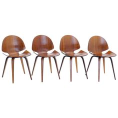 Rare Set of Four George Milhauser for Plycraft Bentwood Dining Chairs | From a unique collection of antique and modern dining room chairs at https://www.1stdibs.com/furniture/seating/dining-room-chairs/