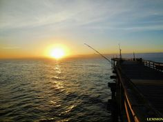 Outer Banks NC Local Artists Facebook post 5/27/15:  Reeling Up the Sun, Avon Pier.  Photographer credit: Mark Lemmon.