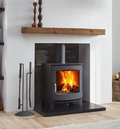 The Dik Geurts Ivar 5 Low is a contemporary and versatile stove. It has a classi…, – Freestanding fireplace wood burning Gas Stove Fireplace, Wood Burner Fireplace, Fireplace Hearth, Home Fireplace, Living Room With Fireplace, Fireplace Design, Home Living Room, Living Room Designs, Tiles For Fireplace